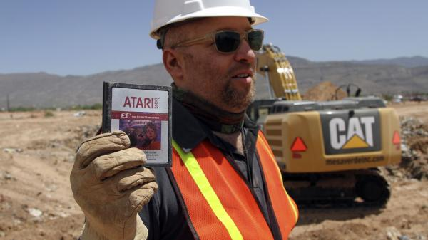 Film director Zak Penn shows a cartridge of the Atari game E.T. The Extra-Terrestrial, which was released in 1982. Millions of copies of the game are rumored to be in a New Mexico landfill.