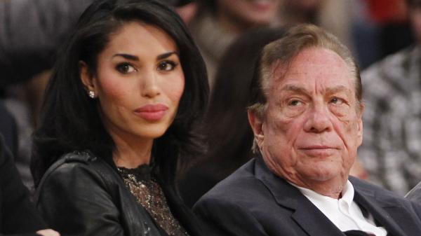 Los Angeles Clippers owner Donald Sterling and V. Stiviano watch the Clippers play the Los Angeles Lakers during a 2010 NBA preseason game.