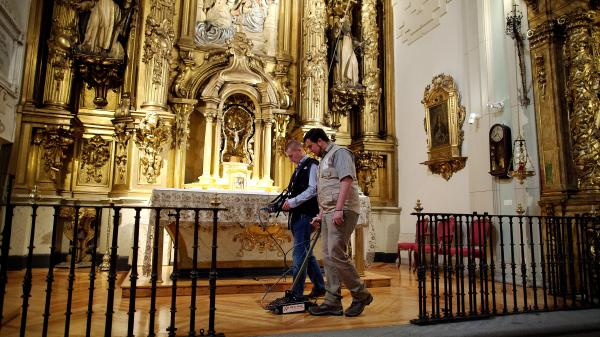 Researchers search for the remains of writer Miguel de Cervantes at <em>Convento de las Trinitarias Descalzas,</em> or Convent of the Barefoot Trinitarians, on Monday in Madrid. Cervantes died in 1616, and his dying wish was to be buried here — the nuns of the convent helped negotiate his freedom after pirates captured and imprisoned him for five years.