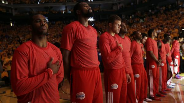 In a protest against comments attributed to Los Angeles Clippers owner Donald Sterling, the team's players wore their red warm-up shirts inside out to hide the team's logo. The NBA is still working to confirm Sterling made the controversial statements.