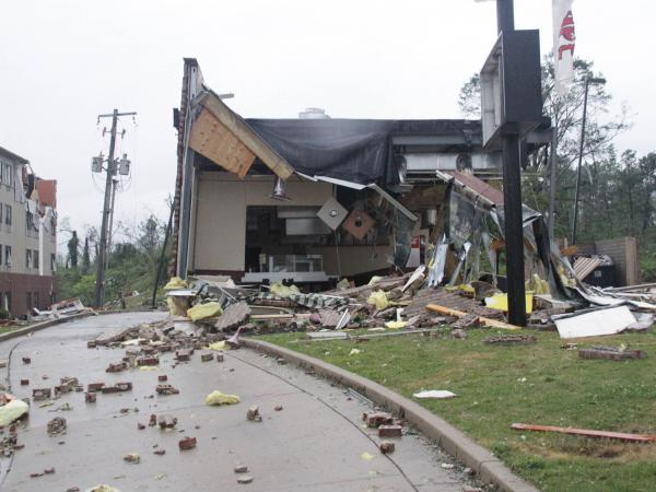 A motel and restaurant show significant damage from a tornado that ripped through Tupelo, Miss., on Monday.