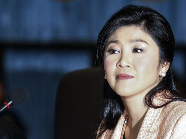 Thai Prime Minister Yingluck Shinawatra attends a meeting with the Election Commission in Bangkok on Wednesday. The commission has recommended fresh elections to be held July 20.