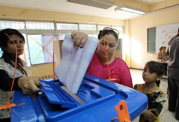 An Iraqi woman casts her vote in Iraq's first parliamentary election since U.S. troops withdrew at a polling station in the capital Baghdad on April 30, 2014. (Ali Al-Saadi/AFP/Getty Images)