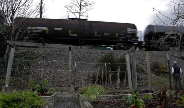 An oil train traveling through Washington state. The company transporting oil-by-rail to a terminal in Clatskanie, Oregon, says it is using only the safer of two tanker-car models that are in wide use. Katie Campbell