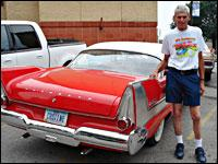 Jerry Gallery of Waterloo, Iowa, poses with his perfectly restored 1958 Belvedere. This is the model used in the horror film <em>Christine</em>, as the license plate suggests.