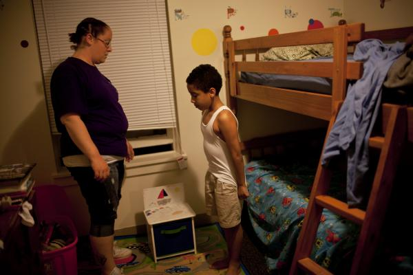 "Stepp speaks to Isaiah before bedtime. ""Sometimes I think I have done something wrong for them to turn their backs to me,"" she says of her failed relationships with her children's fathers. ""But then there are other times that I'm in a good mood and think, 'Oh, well. Let them go. If they don't want to do it, I can do it. I can be the mother and father at the same time.' """