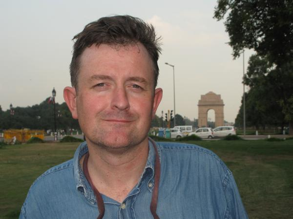 Tarquin Hall, shown here near the Rajpath in Delhi, is a British-born journalist and author. <em>The Case of the Missing Servant</em>, the first book in the Vish Puri series, was his first mystery novel.