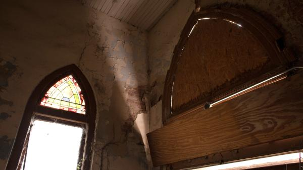 Windows are boarded up inside Centennial Baptist Church.