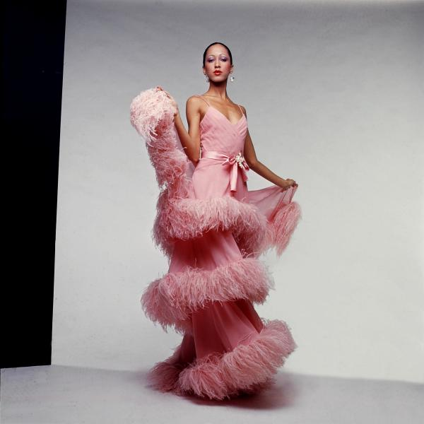 An evening ensemble modeled by Pat Cleveland made of silk chiffon and ostrich feathers by Italian designer Valentino Garavani, 1974-75.