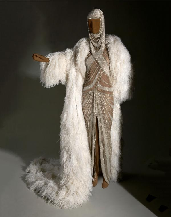 An evening gown of synthetic net glass beads and ostrich feathers from American designer Bob Mackie, 2001-02.