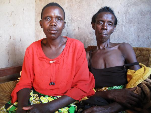 "Godleaves Mukamunana, left, hid Domitil Mukakumuranga, in her house for weeks so that Hutu militias wouldn't kill her. ""Seeing her alive is the best thing,"" Mukamunana says. ""That kind of relationship we have is priceless. The fact that I don't have more like her --€"" those who were killed — that's what's hurting."""