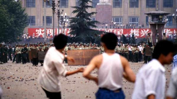 After People's Armed Police were deployed to clear the square on June 4, pitched battles broke out between police and angry crowds throwing stones.