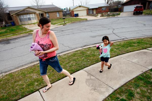 Tiffany Contreras walks her daughter Kyndall, 4, to preschool at Disney Elementary in Tulsa, Okla.