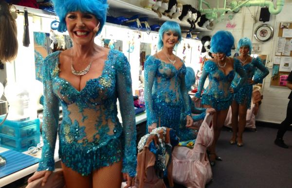 "With their matching blue wigs, the dancers in the Palm Springs Follies chorus (they're called the ""long-legged lovelies"") give a whole new meaning to the cliche ""blue-haired old ladies."""