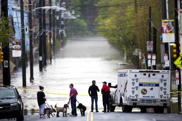 People gather to view floodwaters from the Schuylkill River in Philadelphia. Flood warnings Thursday stretched from Mississippi to Massachusetts. <br /><br />