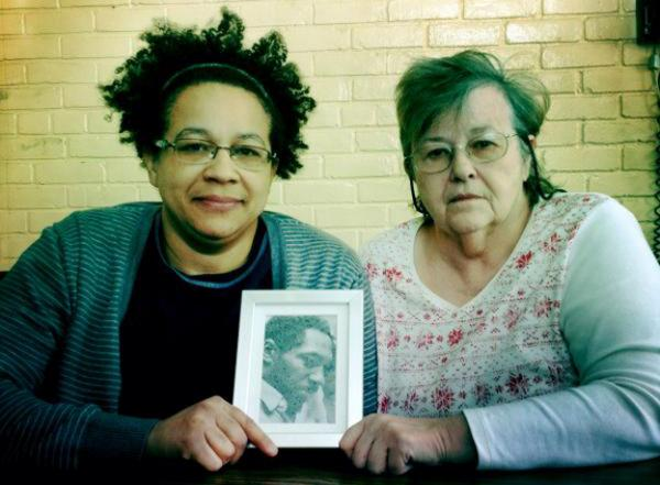 Tamara Kamara, Robinson's youngest child, and widow, Cheryl Buswell-Robinson. (Sarah Hulett/Michigan Radio)