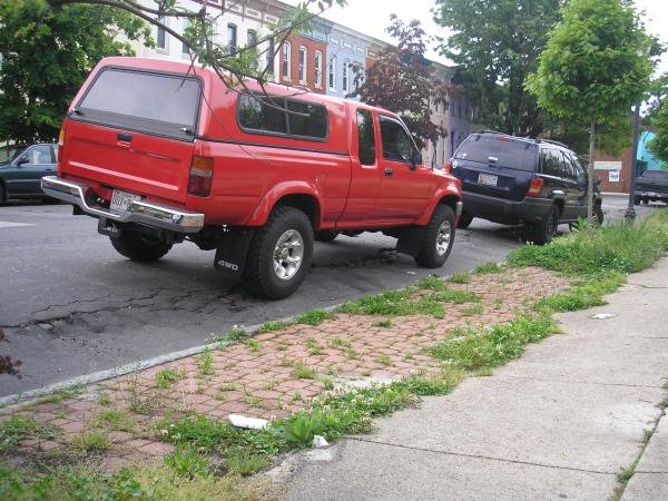 Cars parked along the East 26th Street in May 2013.  Residents took the picture to show how low the ground is.