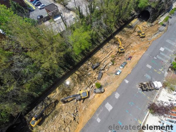 Aerial perspective of from the drone-mounted camera of the street collapse in Charles Village.
