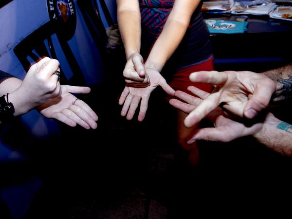 Contestants compete in a rock-paper-scissors tournament in Gainesville, Fla., in 2012. A new study indicates it's not as random as it seems.