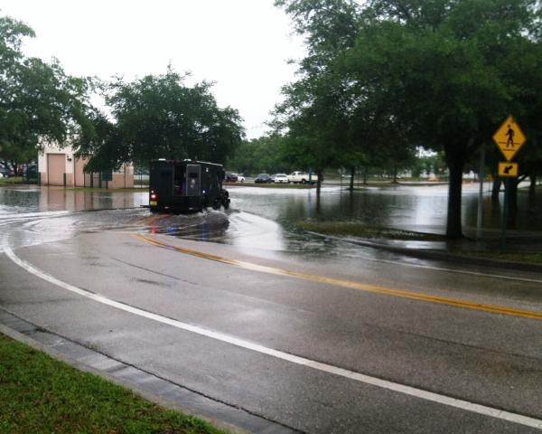 A police vehicle leaves a wake on USF Willow Drive