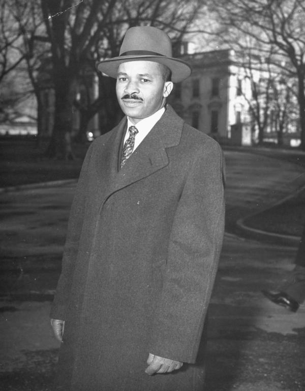 Reporter Harry McAlpin leaves the White House in 1944. McAlpin was the first black reporter to cover a presidential press conference. He'll be honored Saturday at the Correspondents' Dinner.