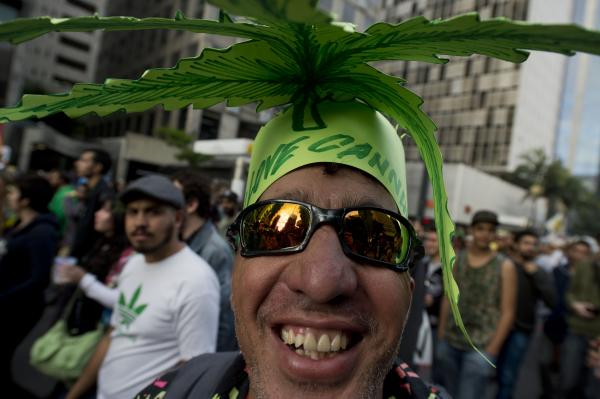 People smoke marijuana, presumably, <em>because</em> it affects their brains, not despite that fact. Above, people in Sao Paulo, Brazil, campaign for the legalization of marijuana.