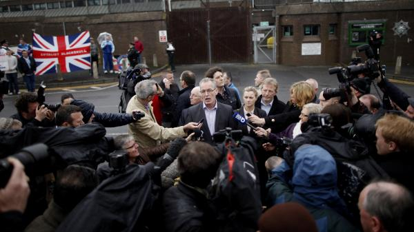 Sinn Fein's Gerry Kelly speaks to the media outside Antrim's police station in Antrim, Northern Ireland, Sunday. Police released Sinn Fein leader Gerry Adams after five days of questioning him about the 1972 murder of Jean McConville.