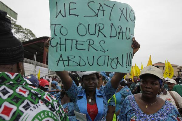 Nigerian women attend a demonstration calling on the government to rescue kidnapped school girls.