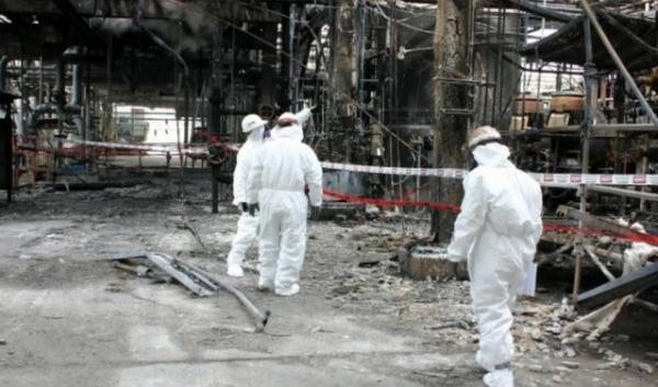 Chemical Safety Board investigators inspect wreckage at the Tesoro-Anacortes refinery in 2010.