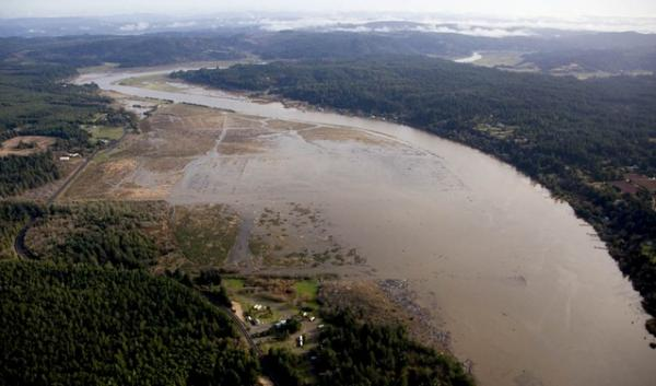 Aerial View of the Ni-les'tun Unit looking east as it floods about an hour before high tide November 25, 2011. The U.S. Fish and Wildlife Service restored 400 acres of tidal wetlands in Bandon Marsh National Wildlife Refuge.