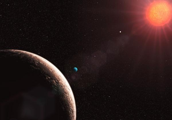 "Gliese 581e (foreground) is part of <a href=""http://en.wikipedia.org/wiki/Gliese_581"">a system of planets</a> around a red dwarf sun that may include a body orbiting in the habitable zone."