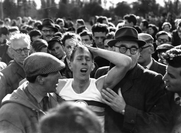 English athlete Roger Bannister among a crowd at Oxford after becoming the first person in the world to run a mile in under 4 minutes (3:59.4).