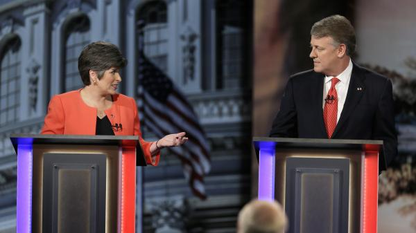 Iowa Republican state Sen. Joni Ernst debates fellow U.S. Senate candidate Mark Jacobs, a retired CEO, in April.