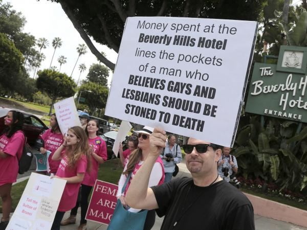 People protest outside the Beverly Hills Hotel, which is owned by the Sultan of Brunei, over the country's Shariah law penal code in Beverly Hills, Calif., on Monday.