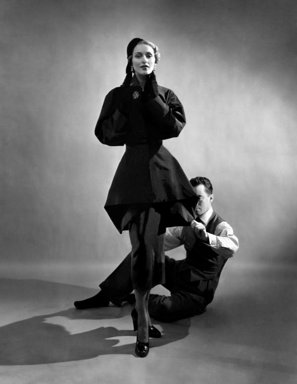 James pins a suit on a model, possibly Ricki Van Dusen, in 1948.