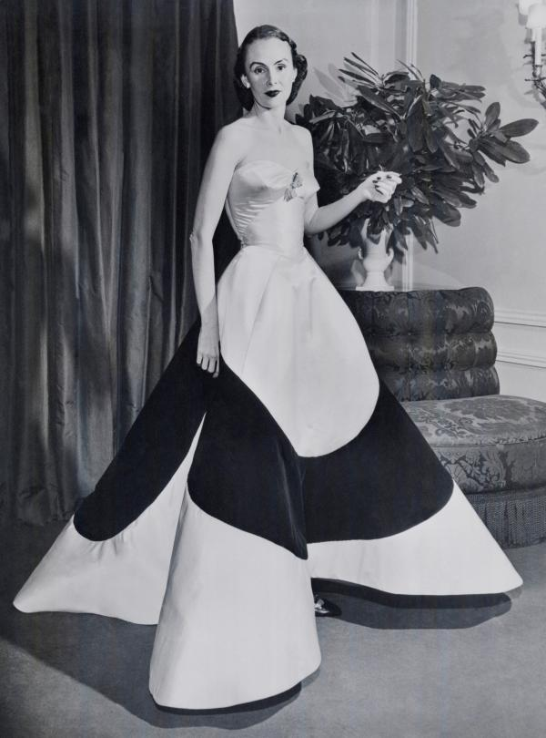 Austine Hearst, wife of William Randolph Hearst Jr., wears the Clover Leaf gown she commissioned for President Eisenhower's inauguration in 1953. Hearst had to wear something else to the ceremony when James couldn't finish the gown on time.