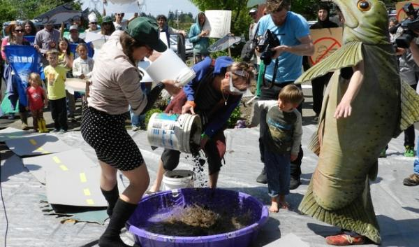 Protesters dressed as Forest Service employees dumped mud into a swimming pool at a demonstration at the Mt. Hood National Forest headquarters.