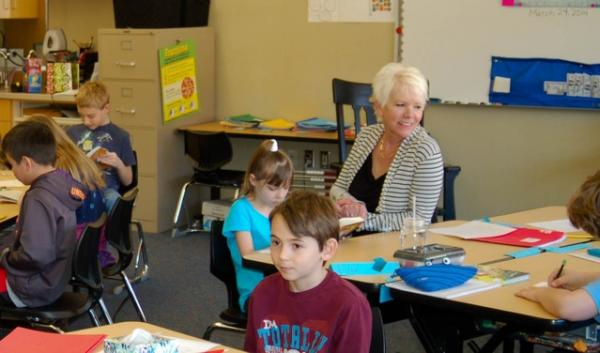 Third-grade teacher Nancy Avery helps her class during reading time. Avery taught in a portable classroom for 27 years. This is her first year inside a brick-and-mortar building at Jefferson Elementary in Spokane, Washington.