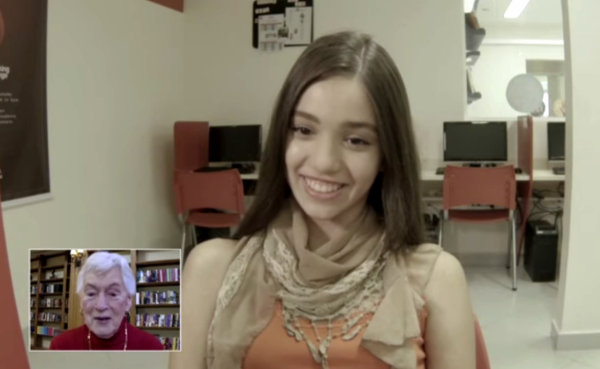 A Brazilian student speaks with an American senior in this screenshot from a video about the program. (Screenshot)