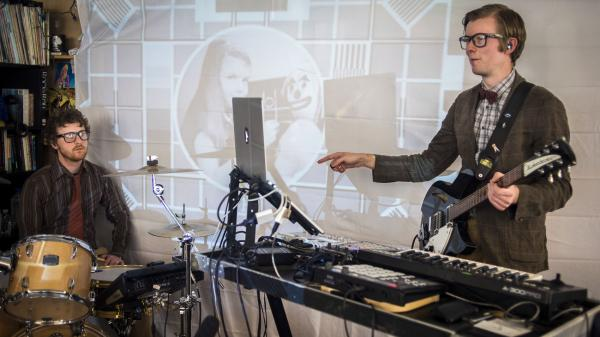 Public Service Broadcasting performs at a Tiny Desk Concert in March 2014.
