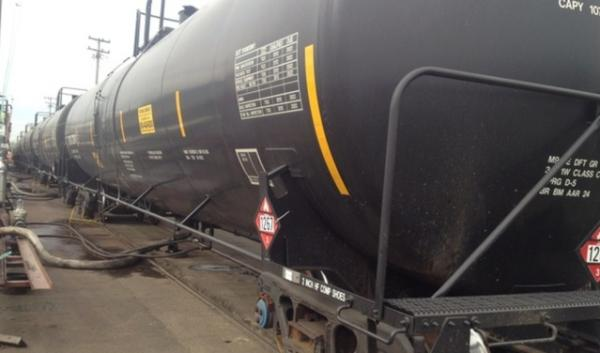 Tank cars carrying petroleum crude oil are stationed at a former asphalt plant near the Willamette River in Northwest Portland. The plant was recently purchased by Arc Logistics.