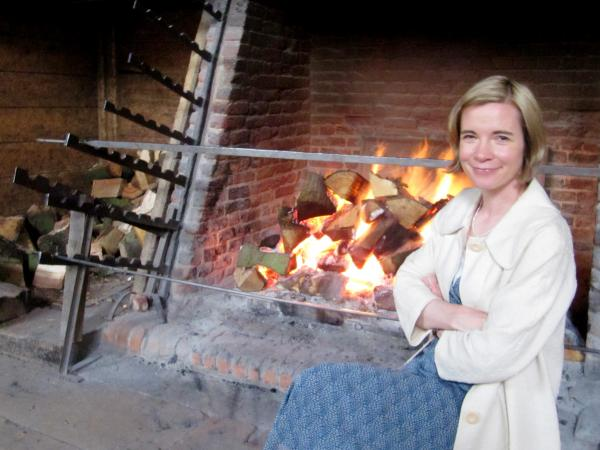 Lucy Worsley, chief curator at the Historic Royal Palaces in London, attempted to roast on a spit powered by a dog in a wheel at the George Inn. Coco didn't fare too well in the wheel.