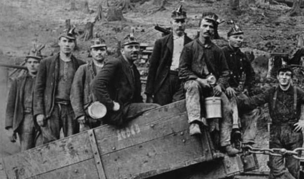 This photo, probably taken between 1905 and 1910, shows a group of coal miners at the early entrance of a mine near Newcastle, Washington. Coal mining could return to eastern King County under a proposal that many residents oppose.
