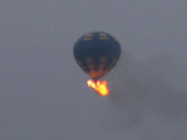 This photo provided by Nancy Johnson shows what authorities say is a hot air balloon that caught fire and crashed in Virginia on Friday.