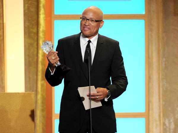 Larry Wilmore accepts the best talk show award for <em>The Daily Show with Jon Stewart</em> at the Critics' Choice Television Awards in June 2013.