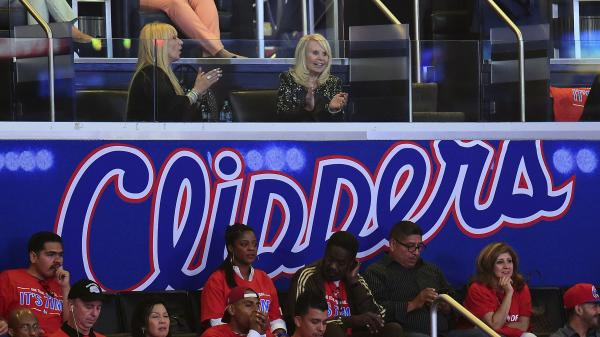 Shelly Sterling (top right), wife of embattled L.A. Clippers owner Donald Sterling, watches Friday's Game 3 of the Clippers playoff series. The NBA says that if Donald Sterling is forced out, his wife cannot keep the team, either.