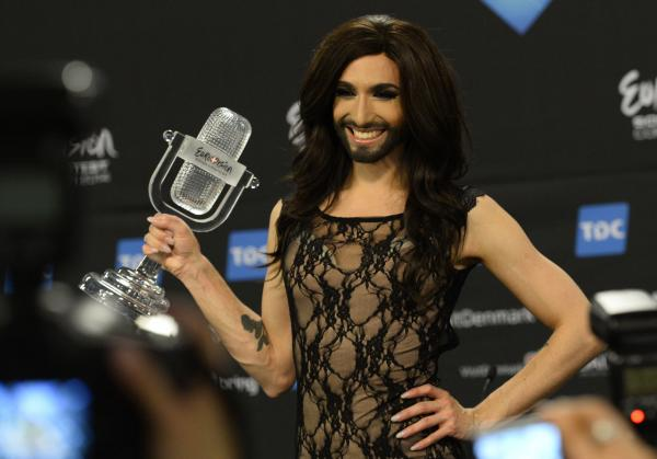 Conchita Wurst, representing Austria, poses with the trophy after winning the Eurovision Song Contest 2014 Grand Final in Copenhagen, Denmark, on May 11, 2014. (Jonathan Nackstrand/AFP/Getty Images)