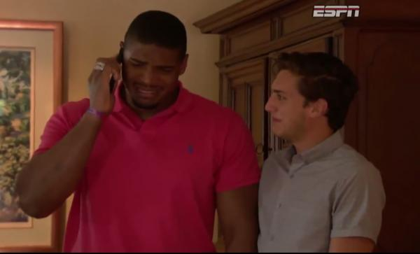 Newly drafted NFL player Michael Sam, standing alongside his boyfriend Vito Cammisano, becomes emotional as he learns he will be playing for the St. Louis Rams. (Screenshot)