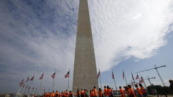 Students from Bridge Street Middle School in Wheeling, W.Va., walk at the Washington Monument, ahead of a ceremony Monday to celebrate its reopening nearly three years after it was closed following damage sustained during an earthquake in August 2011.