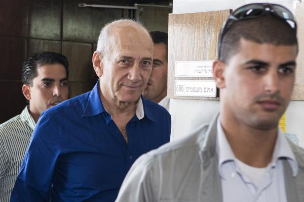 Former Israeli Prime Minister Ehud Olmert leaves Tel Aviv's district court Wednesday. Olmert was sentenced to six years in prison and a fine of 1 million shekels ($290,000) for his role in one of the country's worst-ever corruption scandals.
